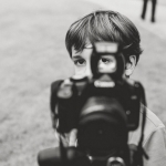 Photographer's eye catching kid's eye through the lens at Auch in Gers region