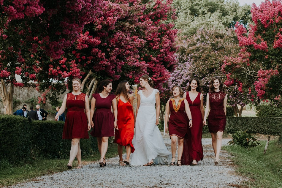 Bridesmaids in wine-coloured dresses at the Chateau d'Amou in Landes region